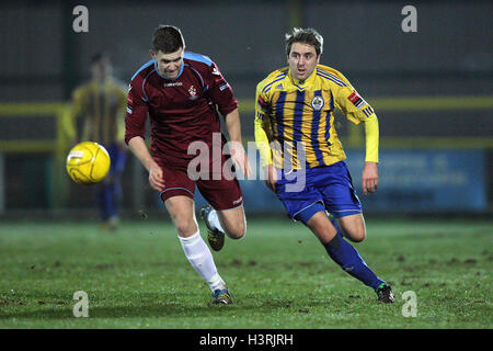 Kurt Smith of Romford evades Sam West of Brentwood - Romford vs Brentwood Town - Ryman League Division One North - Stock Photo
