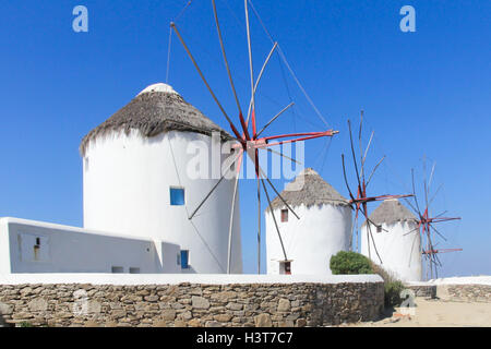 Iconic windmills in Chora, Mykonos, Greece - Stock Photo