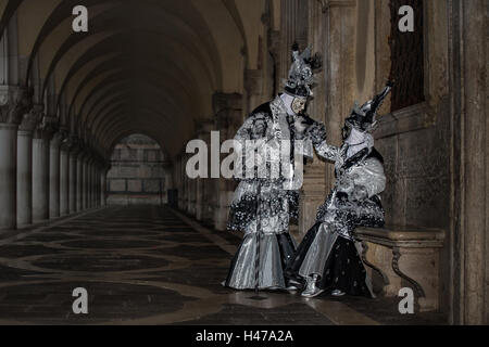 Two people dressed up for the Carnival in Venice, Italy - Stock Photo