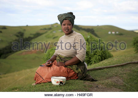 Africa, South Africa, Eastern Cape, Wild Coast, Transkei, sitting on the floor, eating from bowl, painted on the - Stockfoto