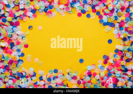 Colorful Confetti frame on yellow Background - Stock Photo