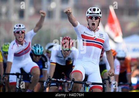 Norwegian Kristoffer Halvorsen celebrates as he crosses the finish line to win the men's under 23 road race at the - Stock Photo