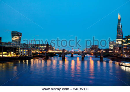 London skyline at night with The Shard, Tower Bridge and the new skyscrapers of The City. - Stock Photo