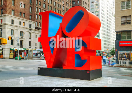 NEW YORK CITY - SEPTEMBER 5: Love sculpture at 55th street with tourists on September 5, 2015 in New York City. - Stock Photo