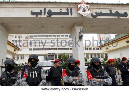 Riot police stand guard as activists and relatives of Ahmed Daqamseh, a Jordanian soldier who was sentenced to life - Stock Photo