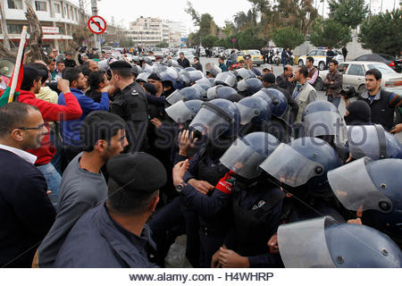 Riot police clash with activists and relatives of Ahmed Daqamseh, a Jordanian soldier who was sentenced to life - Stock Photo