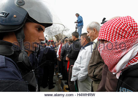 Riot police are seen next to activists and relatives of Ahmed Daqamseh, a Jordanian soldier who was sentenced to - Stock Photo