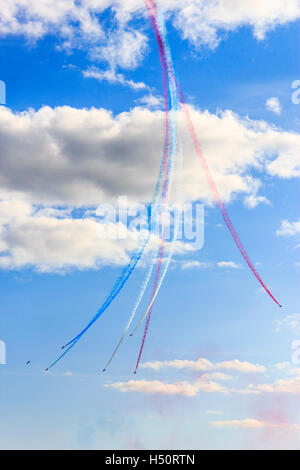 Aerobatic display by the Red Arrows Royal Air Force Aerobatic Team in Weymouth, UK, August 2014 - Stock Photo