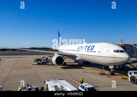 Tokyo, Japan - December 5, 2014: A United Airlines plane being serviced on the tarmac of Narita Airport. - Stock Photo