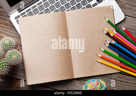 Office and school supplies over wooden desk background for When did table 52 open