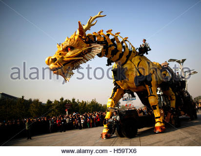 A mechanical installation named 'Long Ma'  makes it way during the Long Ma performance in front of the National - Stock Photo