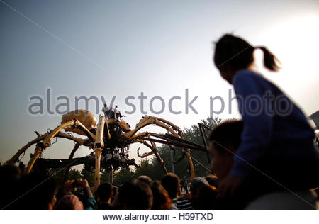 People watch a mechanical installation named 'The Spider'  during the Long Ma performance in front of the National - Stock Photo