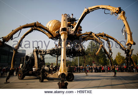 People watch a mechanical installation named 'The Spider'  make its way during the Long Ma performance in front - Stock Photo