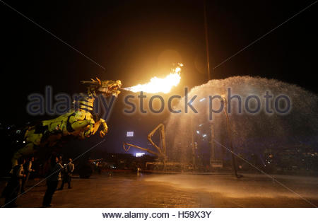 A mechanical installation named 'Long Ma' breathes fire during the Long Ma performance in front of the National - Stock Photo