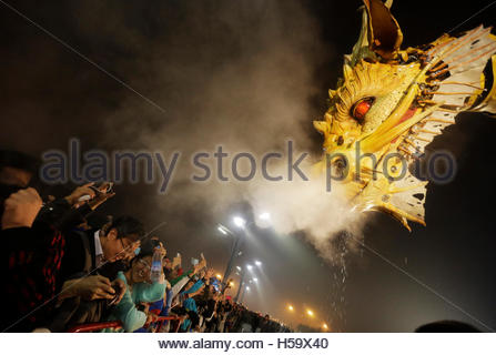 People watch a mechanical installation named 'Long Ma' emit water vapour during the Long Ma performance in front - Stock Photo