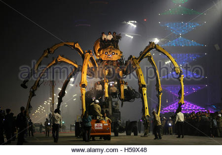 A mechanical installation named  'The Spider' makes it way during the Long Ma performance in front of the National - Stock Photo
