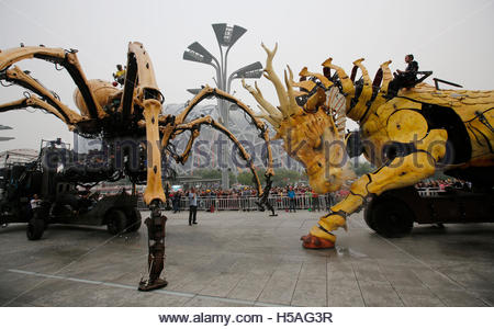 Mechanical installations named 'Long Ma' (R) and 'The Spider' are operated at a rehearsal of the Long Ma performance - Stock Photo