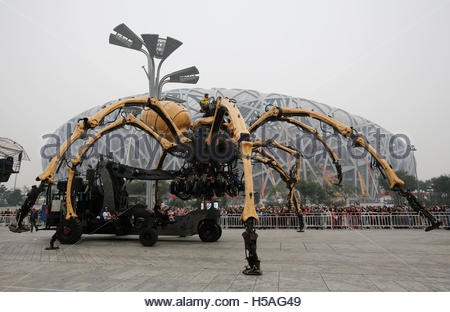 Operators control a mechanical installation named 'The Spider' at a rehearsal of the Long Ma performance in front - Stock Photo