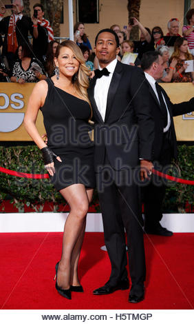 Mariah Carey and husband, Nick Cannon, arrive at the 20th annual Screen Actors Guild Awards in Los Angeles, California - Stock Photo