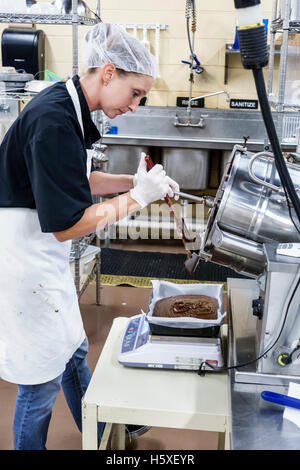 Women On The Production Line Making Cheddar Cheese At
