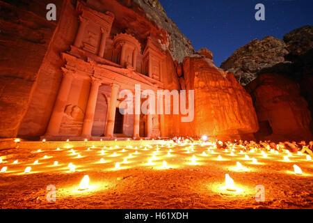 View of the Treasury, Al-Khazneh, at night with candles, Petra, Jordan - Stock Photo