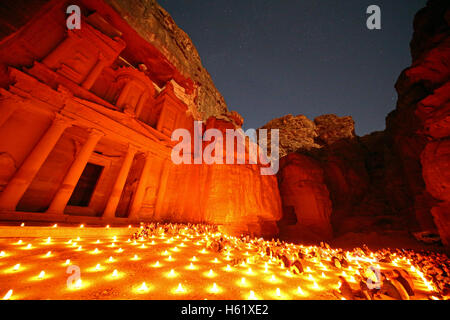 View of the Treasury, Al-Khazneh, at night with candles, Petra, Jordan - Stock Photo