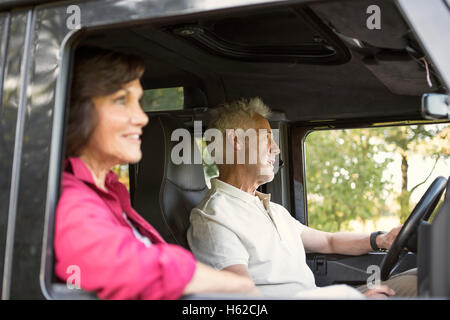 Senior couple on a trip in a cross country vehicle - Stock Photo