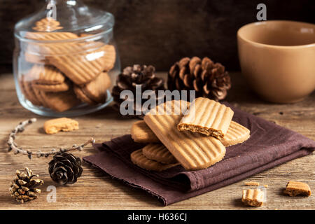 Homemade spicy ginger cookies on rustic wooden table close up, tasty winter ginger pastry - Stock Photo