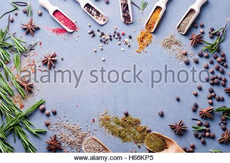 wooden spoons with spices and herbs - Stock Photo