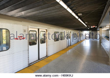 TTC train in Victoria Park Station. Wide angle view of a train in motion in a subway train station. - Stock Photo