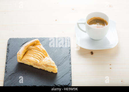 An apple pie with a black coffee. - Stock Photo