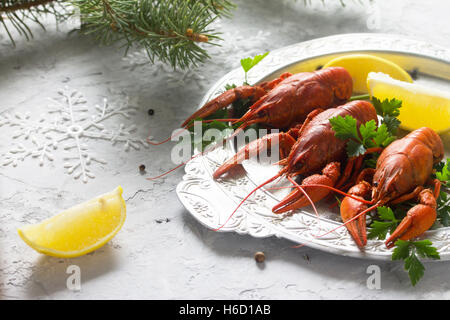 Boiled crawfish, lemon and parsley on a concrete background. Appetizer for Christmas or New Year's table. Food background. - Stock Photo