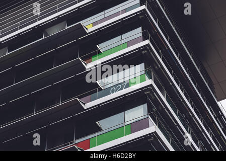 Abstract modern office building. Dark mood. Low angle view - Stock Photo