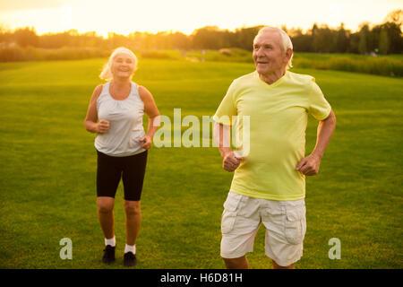 Couple of seniors jogging. - Stock Photo