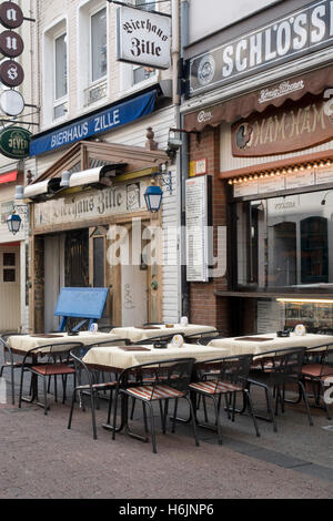 view of a pub with outdoor tables during the summer tourist season stock photo royalty free. Black Bedroom Furniture Sets. Home Design Ideas