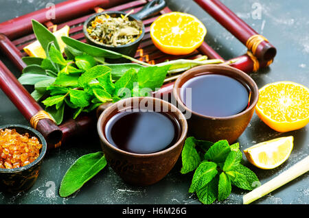 fresh tea in cups and on a table - Stock Photo