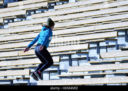 Jumping in stairs. Woman training on stairs. - Stock Photo