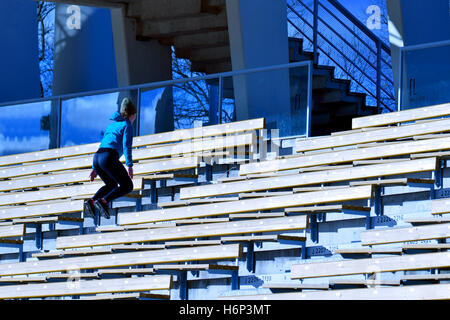 Jump training. Young woman training jumping on stairs. - Stock Photo