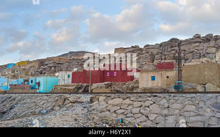 The village of Nagaa Al Khalasab in Upper Egypt with the traditional colorful clay houses on the hill among the - Stock Photo