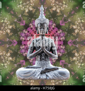Buddha statue sitting in lotus in abstract mandala picture - Stock Photo