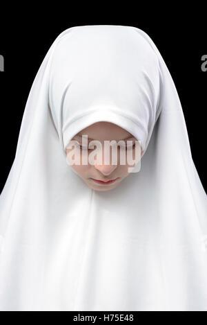 Muslim Girl in Hejab on Black Background - Stock Photo