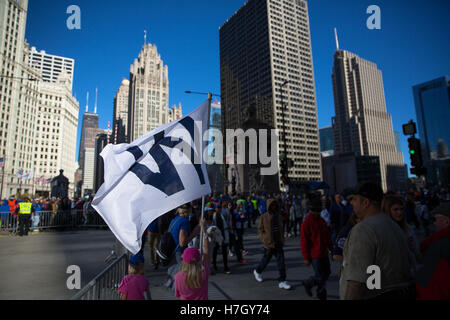 Chicago, Illinois, USA. 4th November, 2016. Fans crowd the streets of downtown Chicago for the Chicago Cubs victory - Stock Photo
