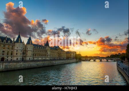 view of the Conciergerie on the Ile de la Cite in Paris, France, at sunset - Stock Photo