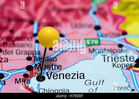 Close up of Venice Italy map with red pin and airplane Travel