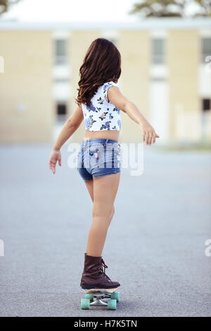 girl riding on skate board - Stock Photo