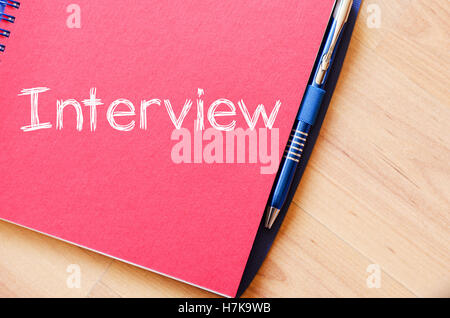 Interview text concept write on notebook - Stock Photo