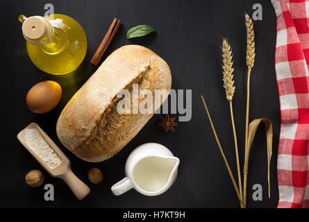 bread and bakery products on wooden background - Stock Photo