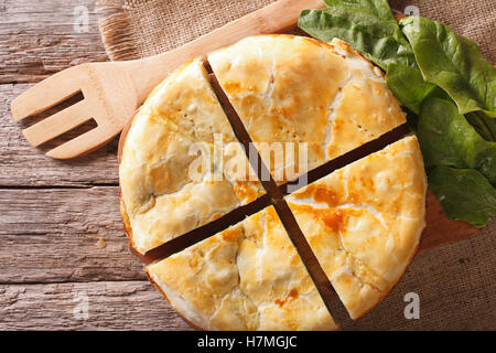 Tasty sliced Greek spanakopita pie close-up on the table. horizontal view from above - Stockfoto
