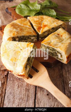 Tasty sliced Greek spanakopita pie close-up on the table. Vertical - Stockfoto