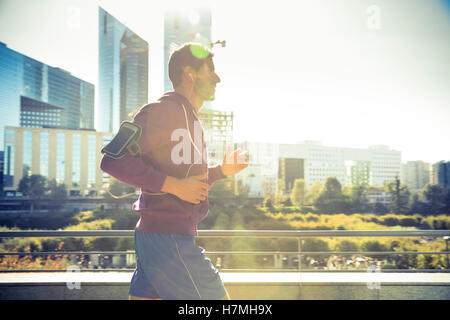 runner with earphones listening music running in the city - Stockfoto